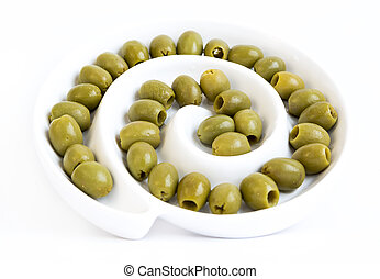 Green olives dish - Green olives in a dish isolated on a...