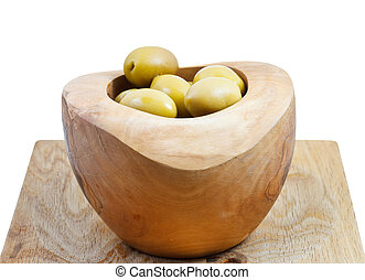 green olives in wooden bowl close up isolated
