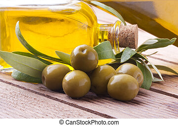 green olives with oil and leaves