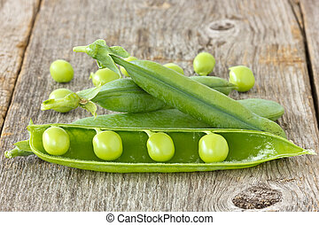 peas on the  wooden background
