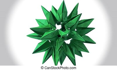 Green origami transforming spiky ball. Amazing rotating...