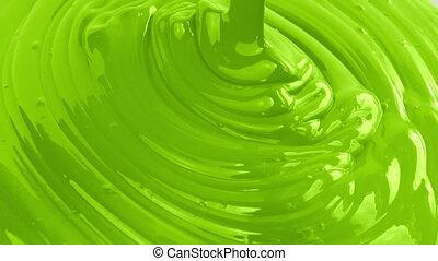 Green Paint Pouring Closeup - Green paint pouring closeup...