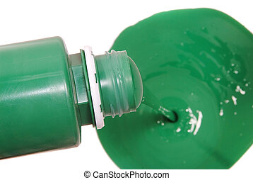 green paint pouring in bucket