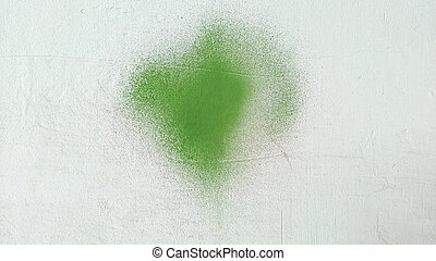 Green paint stain on grunge cement texture. Old gray concrete wall background.