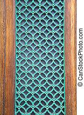 green painted metal grate on city door - green painted ...