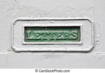 green painter mailbox in a grey house door with the word letters cast in the metal