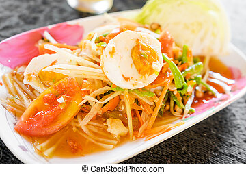 Green papaya salad with salted egg. spicy thai food