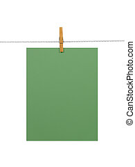 Green paper sheet on a clothes line (+2 clipping paths) -...