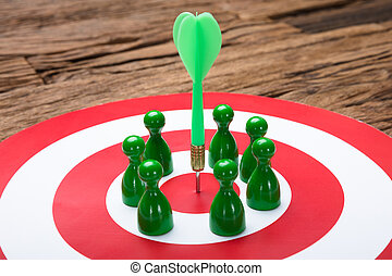 Green Paper Team Surrounding Arrow On Dartboard