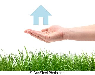 Green Pastures - A hand and house over green grass isolated ...