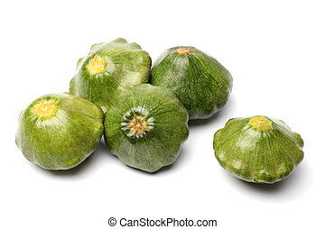 Green pattypan squashes on a white background