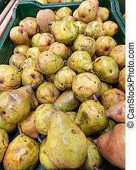 Green pears harvest. Pears in a basket on shelf in supermarket may use as background close up