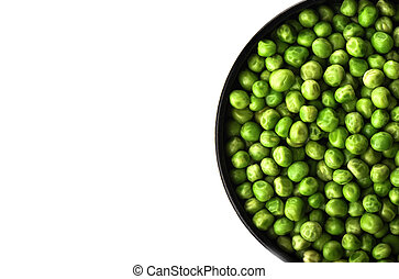 Green peas in a bowl isolated on white background.