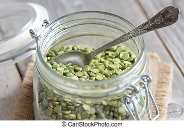 Green peas in a glass jar