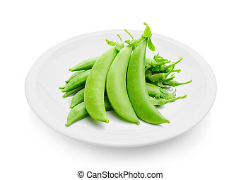 green peas in a plate on white background