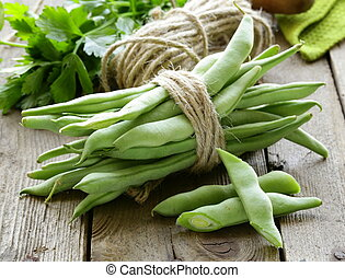 green peas on a wooden table