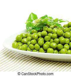 Green peas on plate, food ingredient background