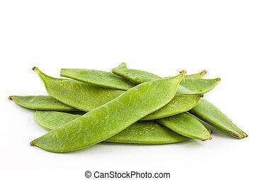 Green peas (Pisum sativum) isolated in white background
