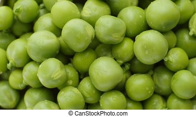 Green peas rotate, top view. - Fresh green peas rotate. Top...
