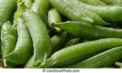 Green peas rotate, top view.