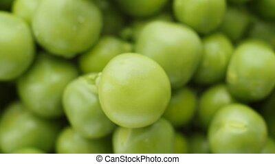 Green peas rotate, top view. - Fresh green peas rotate. Top...