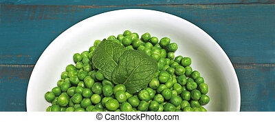 Green peas served in a white bowl