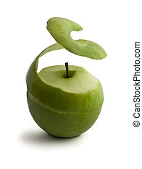 green peeled apple. peel levitates showing pulp