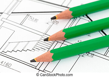 Green pencils on architectural blueprint