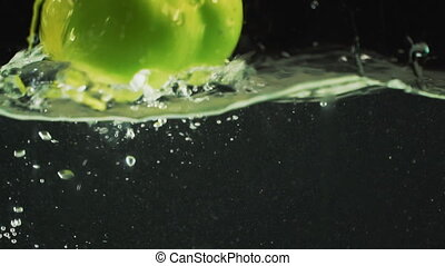 green pepper drops into the water