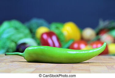 Green pepper on a chopping board