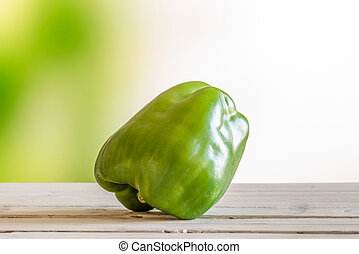 Green pepper on a wooden table