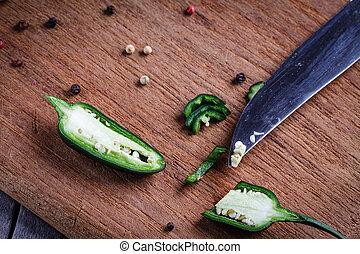 Green pepper on cutting board.