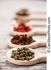 Green peppercorns - Spices in wooden spoon focus on green ...