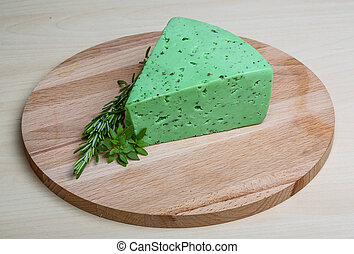 Green pesto cheese and basil leaves