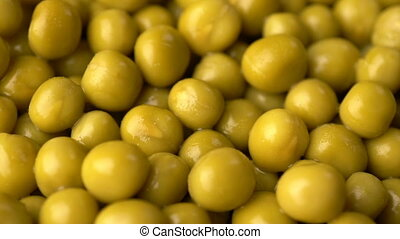 Green pickled peas rotate background. Slow motion footage