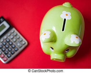 Green piggy bank and calculator