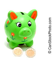 green piggy bank with coins