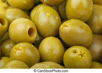 Green pitted olives - Abstract background: green pitted ...