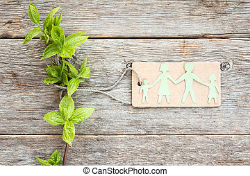 Green plant and paper cutout family