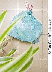 Green Plastic Bag - A green trash bag on the floor, seen ...