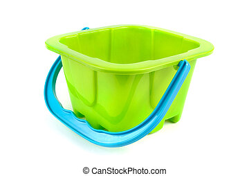 Green plastic kids bucket on white