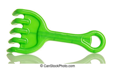 Green plastic rake to play in sandbox isolated on white.