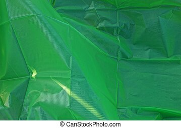 green plastic texture of a piece of crumpled cellophane