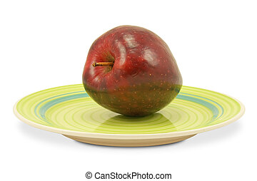 green plate with red apple