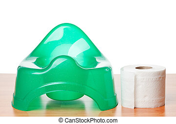 green potty with toilet paper