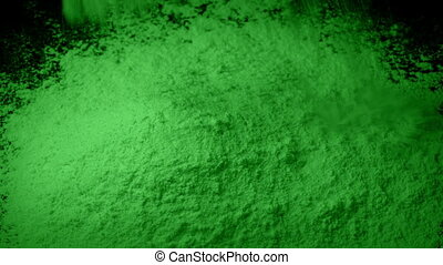 Green Powder Is Poured Into Pile - Green powder pours into...