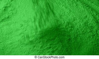 Green Powder Pours Into Pile - Green powder pours into pile...