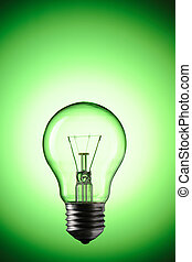Green Power - Light Bulb over colourful background