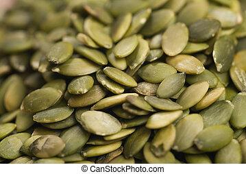 green pumkin seeds background