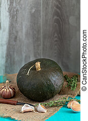 Green Pumpkin and ingredients for tasty vegetarian cooking